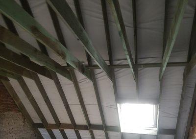 Niew dak met nieuw kapgebinte en sarkingisolatie - Kortrijk